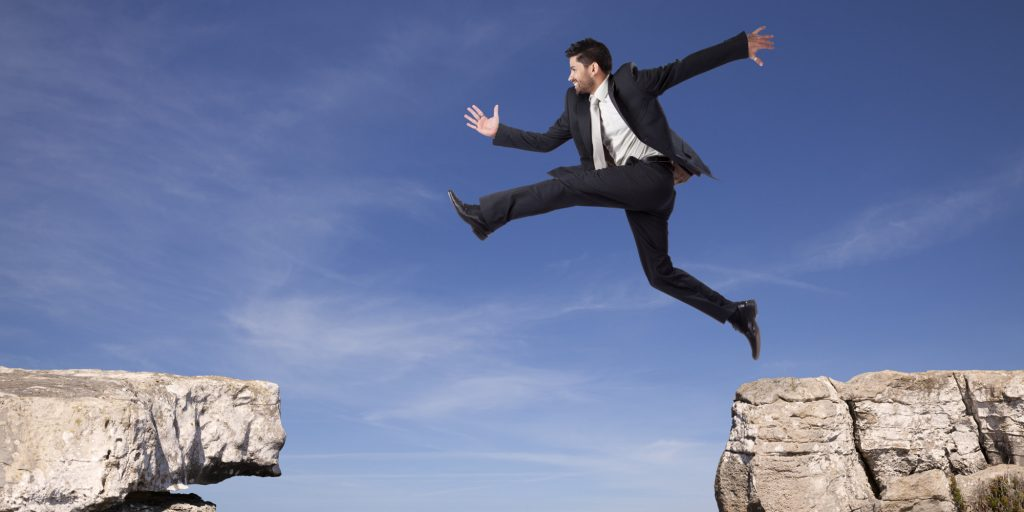 Man taking a leap of faith
